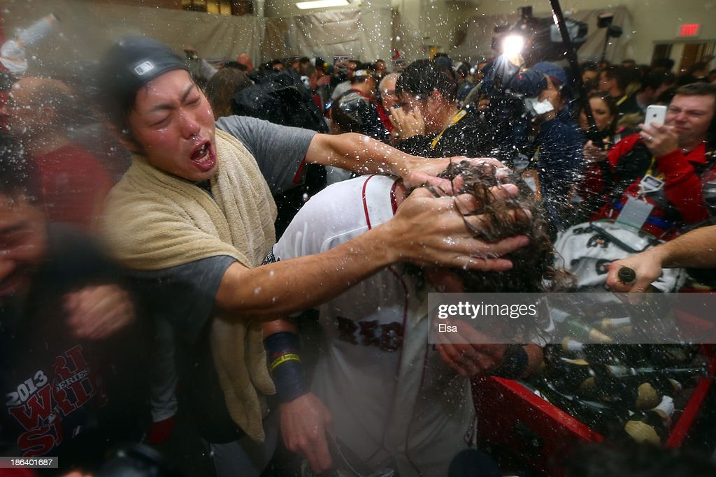 Koji Uehara #19 of the Boston Red Sox celebrates in the locker room after defeating the St. Louis Cardinals 6-1 in Game Six of the 2013 World Series at Fenway Park on October 30, 2013 in Boston, Massachusetts.