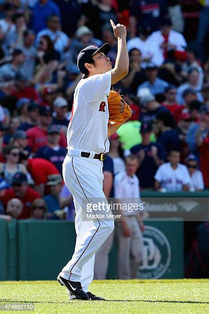 Koji Uehara of the Boston Red Sox celebrates the 61 win over the Los Angeles Angels of Anaheim at Fenway Park on May 24 2015 in Boston Massachusetts