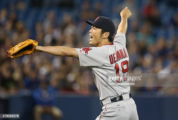 Koji Uehara of the Boston Red Sox celebrates their victory after getting the final out during MLB game action against the Toronto Blue Jays on June...