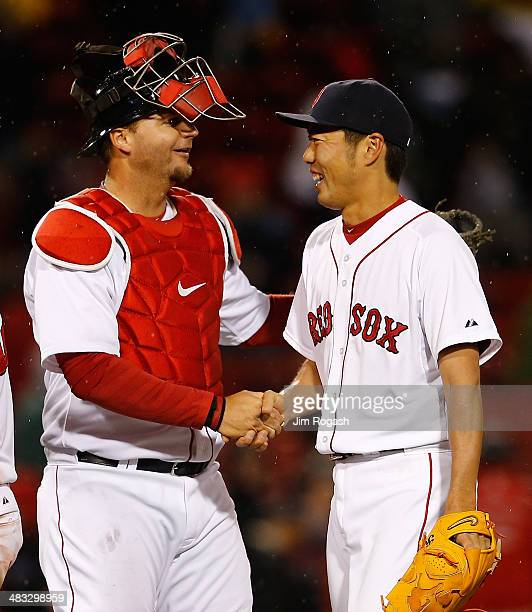 Koji Uehara of the Boston Red Sox celebrates with AJ Pierzynski a pitching in the 9th inning against the Texas Rangers to lead the team to a 51 win...
