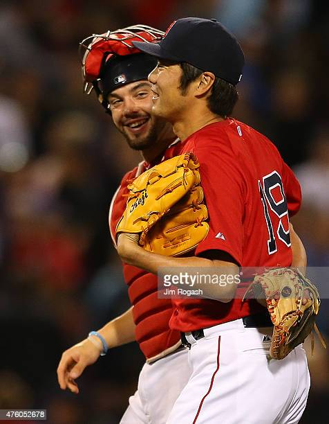 Koji Uehara of the Boston Red Sox celebrates with Blake Swihart after earning a save in the ninth inning against Oakland Athletics at Fenway Park on...