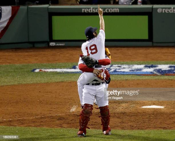 Koji Uehara of the Boston Red Sox celebrates with David Ross after defeating the St Louis Cardinals 61 in Game Six of the 2013 World Series at Fenway...