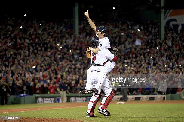 Koji Uehara of the Boston Red Sox celebrates with David Ross after defeating the St. Louis Cardinals 6-1 in Game Six of the 2013 World Series at...