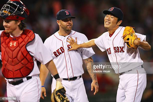 Koji Uehara of the Boston Red Sox celebrates with Mike Napoli after the game against the Miami Marlins at Fenway Park on July 8 2015 in Boston...