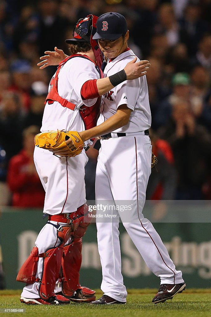 Koji Uehara #19 of the Boston Red Sox celebrates with Ryan Hanigan #10 after defeating the Toronto Blue Jays 4-1 at Fenway Park on April 29, 2015 in Boston, Massachusetts.