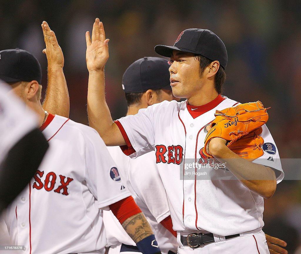Koji Uehara #19 of the Boston Red Sox celebrates with teammates after defeating the Toronto Blue Jays, 7-4, at Fenway Park on June 27, 2013 in Boston, Massachusetts.