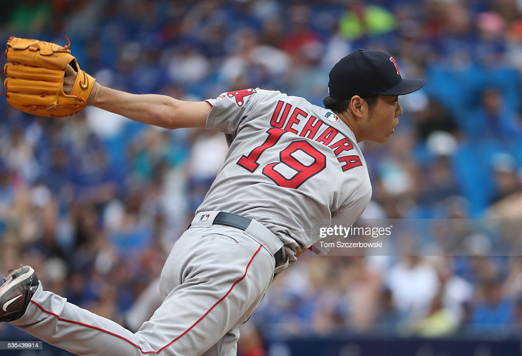 Koji Uehara #19 of the Boston Red Sox delivers a pitch in the eleventh inning during MLB game action against the Toronto Blue Jays on May 29, 2016 at Rogers Centre in Toronto, Ontario, Canada.