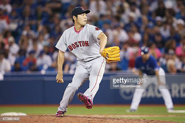 Koji Uehara of the Boston Red Sox delivers a pitch in the ninth inning during MLB game action against the Toronto Blue Jays on May 10 2015 at Rogers...