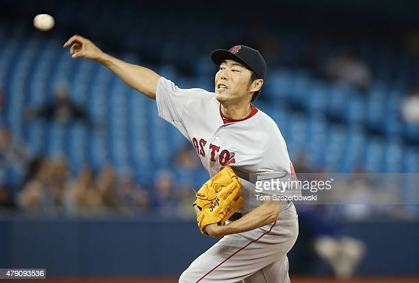 Koji Uehara of the Boston Red Sox delivers a pitch in the ninth inning during MLB game action against the Toronto Blue Jays on June 30 2015 at Rogers...