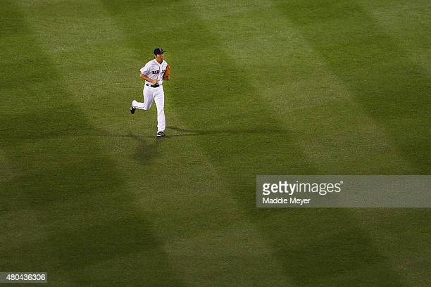 Koji Uehara of the Boston Red Sox enters the field at the start outfield the ninth inning against the New York Yankees at Fenway Park on July 11 2015...