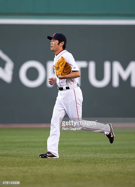 Koji Uehara of the Boston Red Sox enters the game during the ninth inning against the Oakland Athletics at Fenway Park on June 6 2015 in Boston...