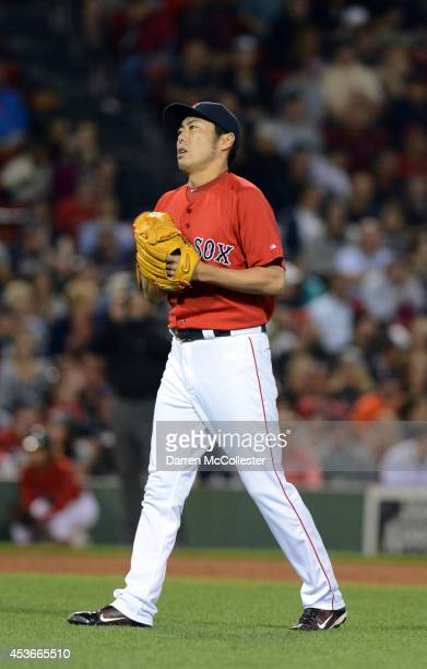Koji Uehara of the Boston Red Sox enters the game in the eighth inning against the Houston Astros at Fenway Park on August 15, 2014 in Boston,...