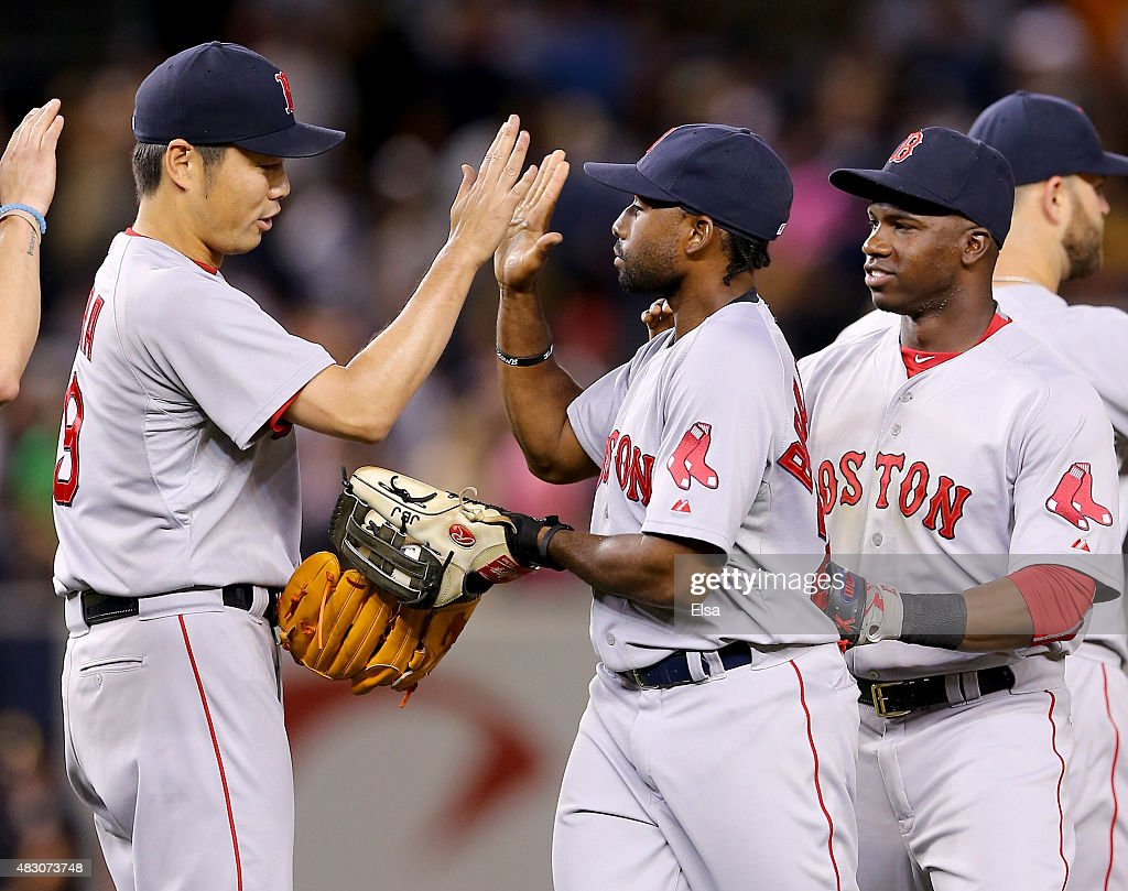 Koji Uehara #19 of the Boston Red Sox is congratulated by teammate Jackie Bradley Jr. #25 after the win over the New York Yankees on August 5, 2015 at Yankee Stadium in the Bronx borough of New York City.The Boston Red Sox defeated the New York Yankees 2-1.
