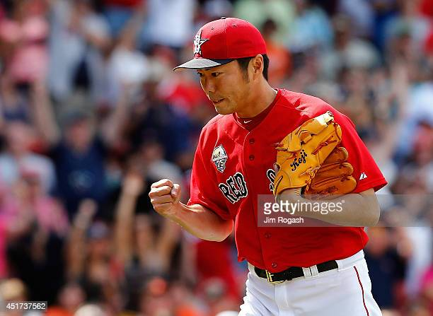 Koji Uehara of the Boston Red Sox leaves the field after throwing a scoreless ninth inning during the first game of a doubleheader at Fenway Park on...