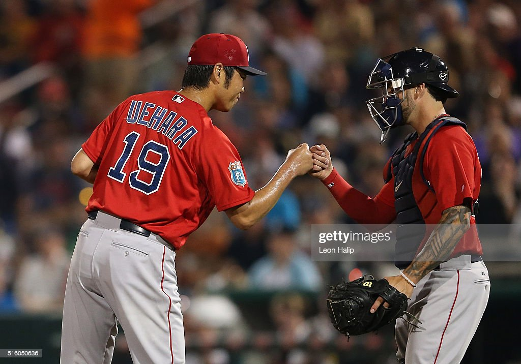 Koji Uehara #19 of the Boston Red Sox leaves the game in the fifth inning and bumps fists with catcher Blake Swihart #23 during the Spring Training Game on March 16, 2016 at CenturyLink Sports Complex and Hammond Stadium, Fort Myers, Florida.