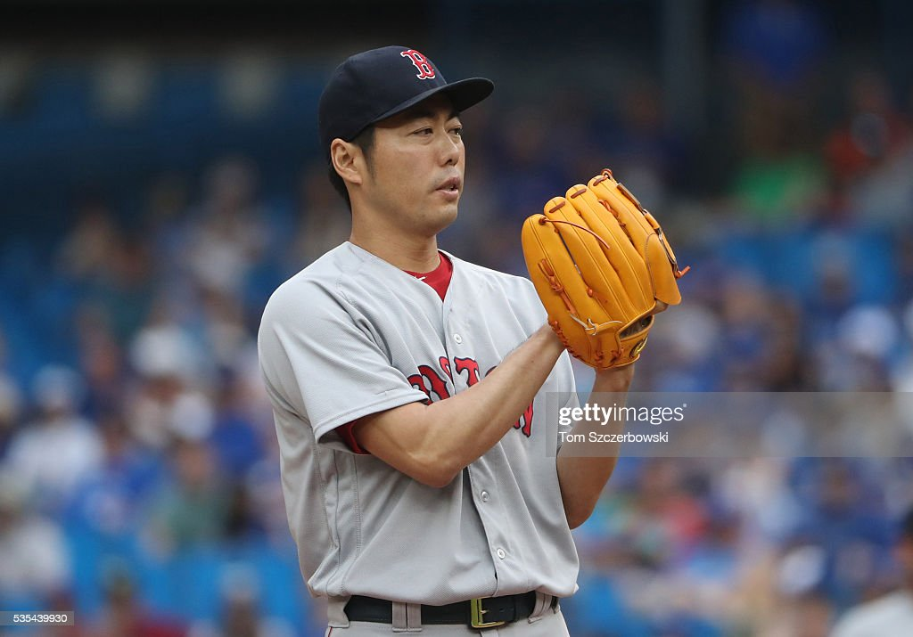Koji Uehara #19 of the Boston Red Sox looks in before delivering a pitch in the eleventh inning during MLB game action against the Toronto Blue Jays on May 29, 2016 at Rogers Centre in Toronto, Ontario, Canada.