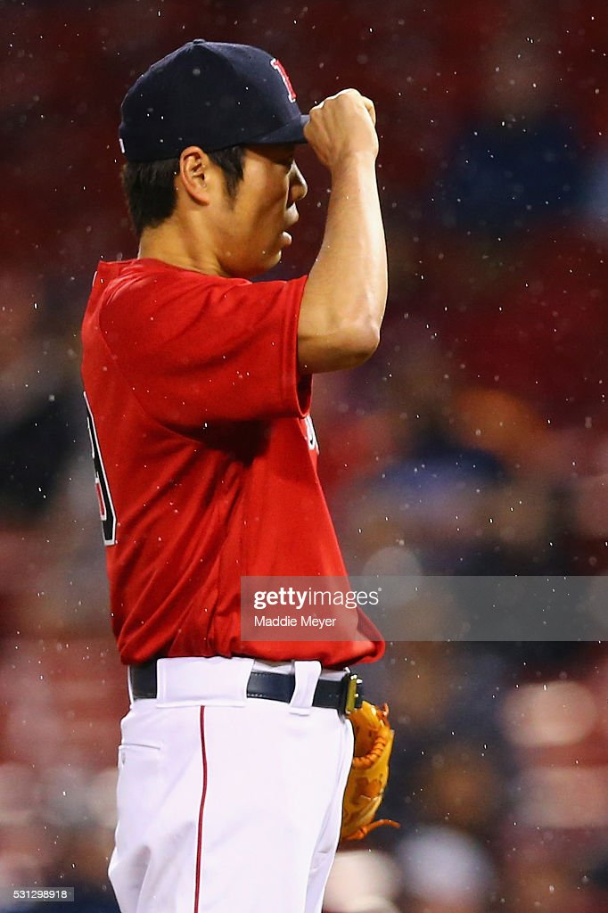 Koji Uehara #19 of the Boston Red Sox looks on during the eighth inning against the Houston Astros on May 13, 2016 in Boston, Massachusetts.
