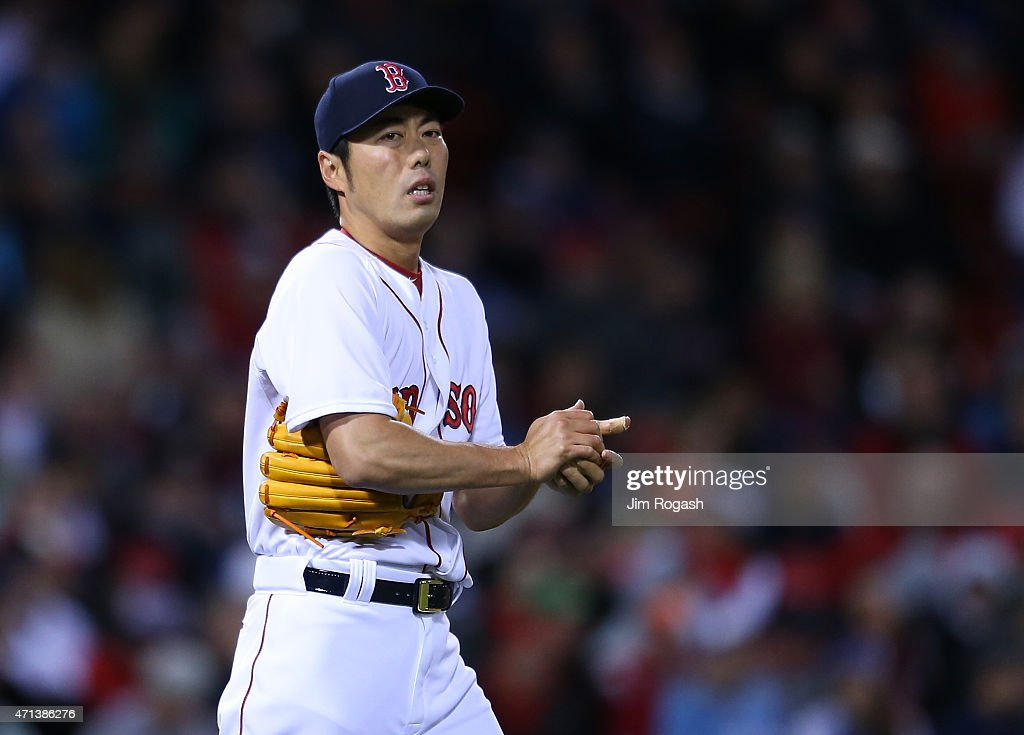 Koji Uehara #19 of the Boston Red Sox pauses between pitches in the ninth inning against the Toronto Blue Jays at Fenway Park April 27, 2015 in Boston, Massachusetts.