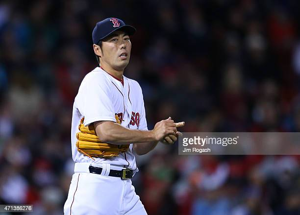 Koji Uehara of the Boston Red Sox pauses between pitches in the ninth inning against the Toronto Blue Jays at Fenway Park April 27 2015 in Boston...