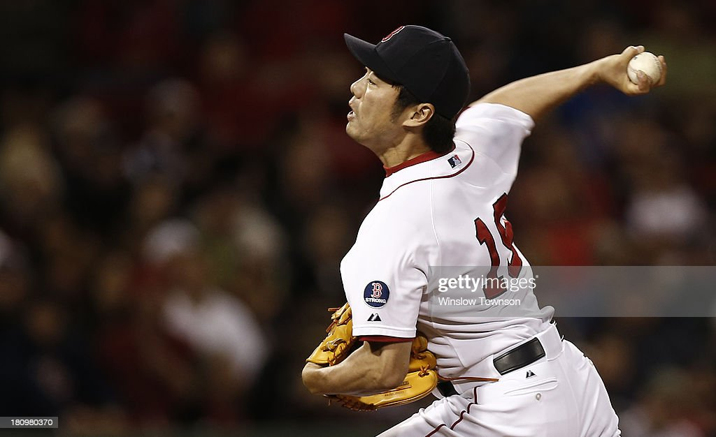 Koji Uehara #19 of the Boston Red Sox pitches against the Baltimore Orioles during the tenth inning of the game at Fenway Park on September 18, 2013 in Boston, Massachusetts.