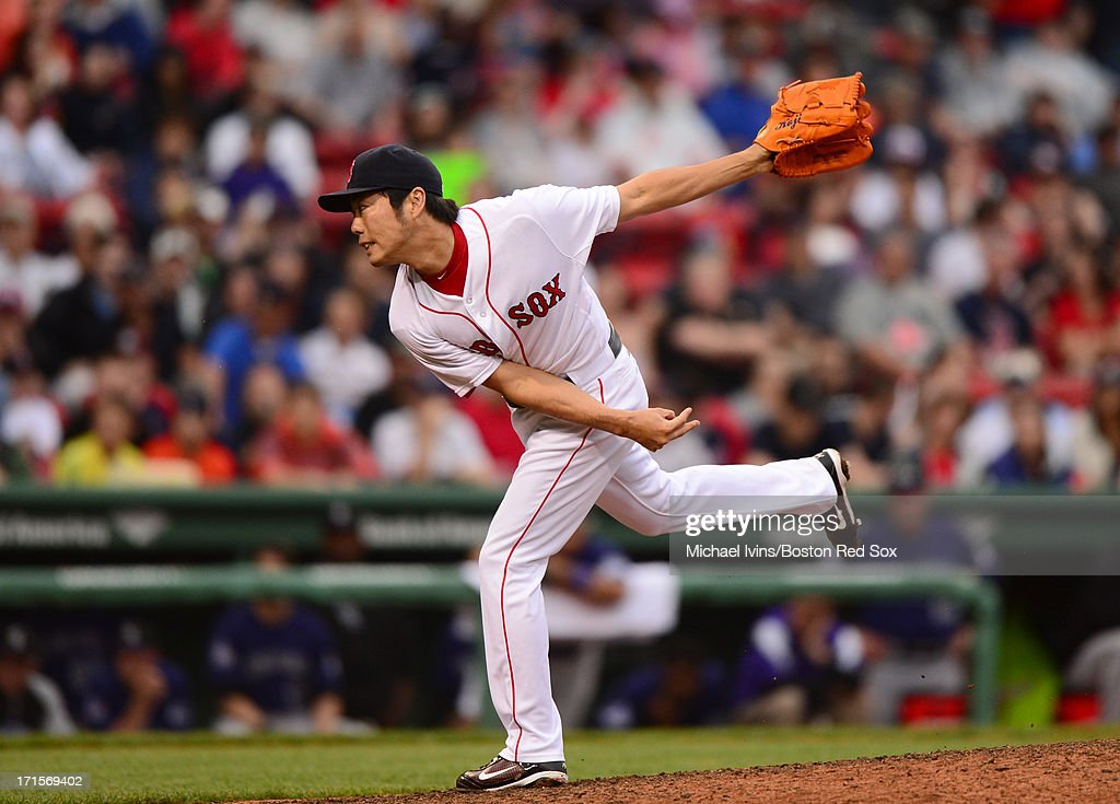 Koji Uehara #19 of the Boston Red Sox pitches against the Colorado Rockies in the ninth inning on June 26, 2013 at Fenway Park in Boston, Massachusetts.
