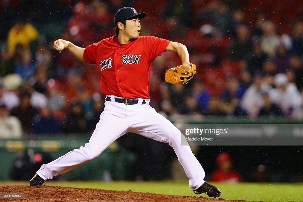 Koji Uehara #19 of the Boston Red Sox pitches against the Houston Astros during the eighth inning on May 13, 2016 in Boston, Massachusetts.