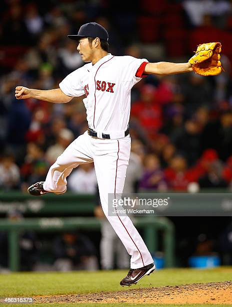 Koji Uehara of the Boston Red Sox pitches against the New York Yankees in the ninth inning during the game at Fenway Park on April 23 2014 in Boston...