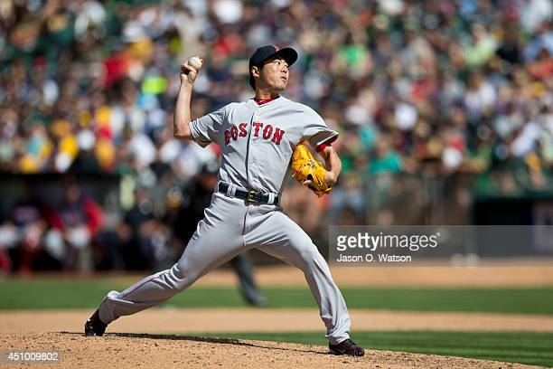 Koji Uehara of the Boston Red Sox pitches against the Oakland Athletics during the tenth inning at O.co Coliseum on June 21, 2014 in Oakland,...