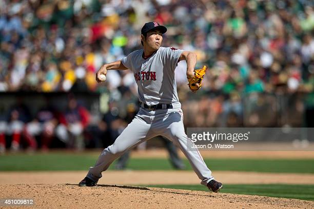 Koji Uehara of the Boston Red Sox pitches against the Oakland Athletics during the tenth inning at Oco Coliseum on June 21 2014 in Oakland California...