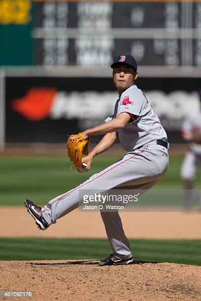 Koji Uehara of the Boston Red Sox pitches against the Oakland Athletics during the ninth inning at Oco Coliseum on June 22 2014 in Oakland California...