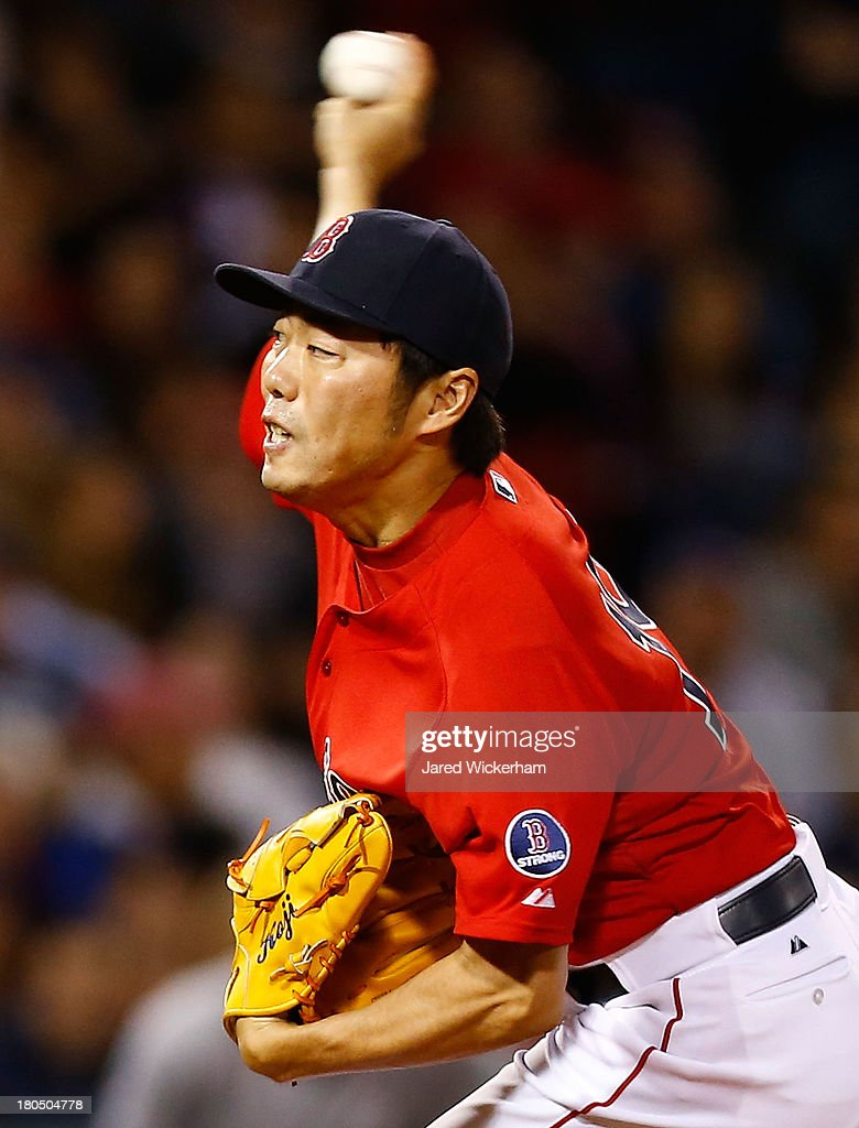 Koji Uehara #19 of the Boston Red Sox pitches in the 9th inning against the New York Yankees during the game on September 13, 2013 at Fenway Park in Boston, Massachusetts.