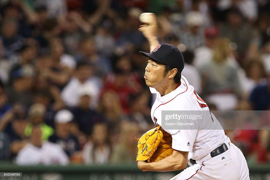 Koji Uehara #19 of the Boston Red Sox pitches in the eighth inning during the game against the Chicago Wite Sox at Fenway Park on June 22, 2016 in Boston, Massachusetts.