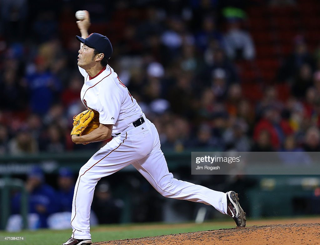 Koji Uehara #19 of the Boston Red Sox pitches in the ninth inning against the Toronto Blue Jays at Fenway Park April 27, 2015 in Boston, Massachusetts.