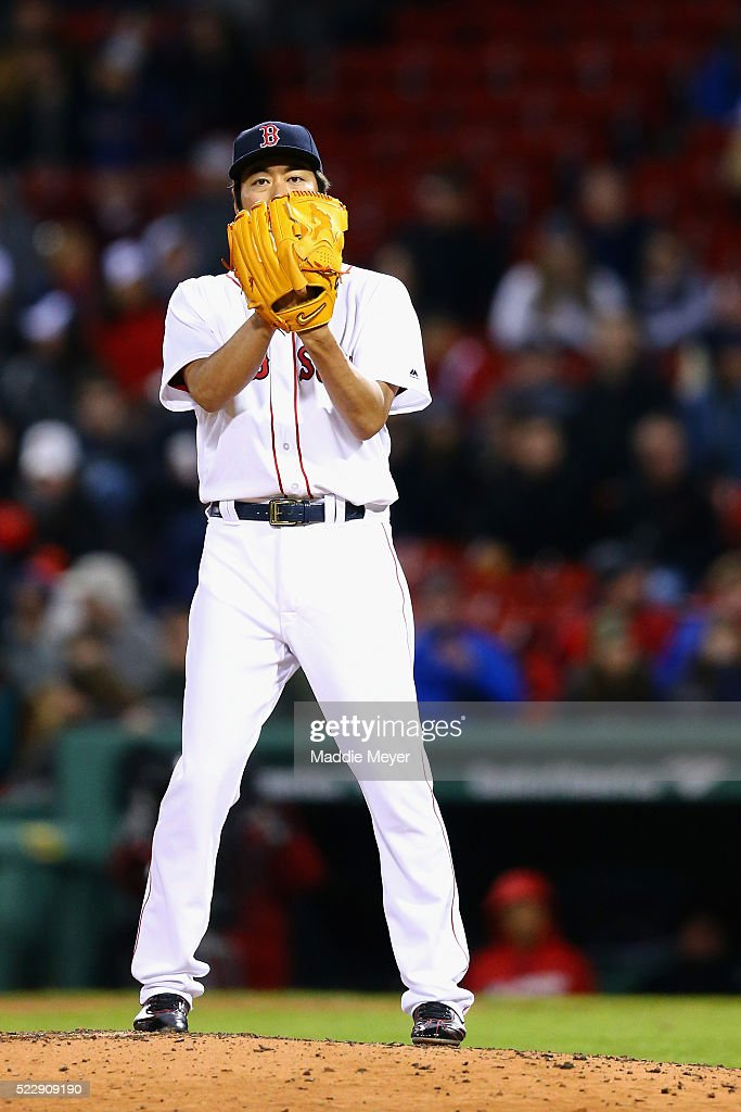 Koji Uehara #19 of the Boston Red Sox prepares to pitch during the eighth inning against the Baltimore Orioles at Fenway Park on April 13, 2016 in Boston, Massachusetts.