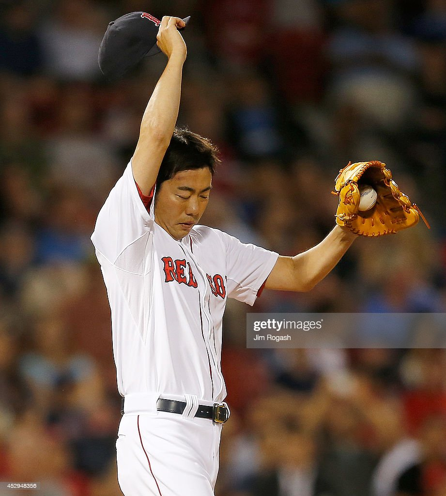 Koji Uehara #19 of the Boston Red Sox prepares to throw in the ninth inning against the Toronto Blue Jays at Fenway Park on July 30, 2014 in Boston, Massachusetts.