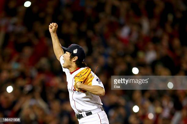Koji Uehara of the Boston Red Sox reacts after defeating the St Louis Cardinals 61 in Game Six of the 2013 World Series at Fenway Park on October 30...