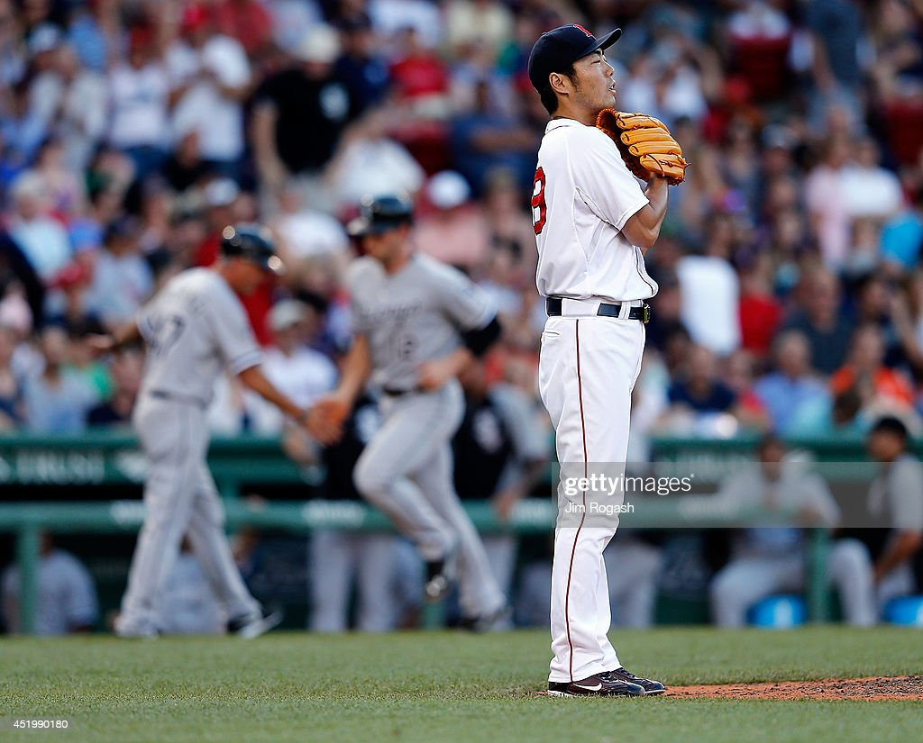 Koji Uehara #19 of the Boston Red Sox reacts after gave up a home run to Conor Gillaspie #12 of the Chicago White Sox in the ninth inning at Fenway Park on July 10, 2014 in Boston, Massachusetts.
