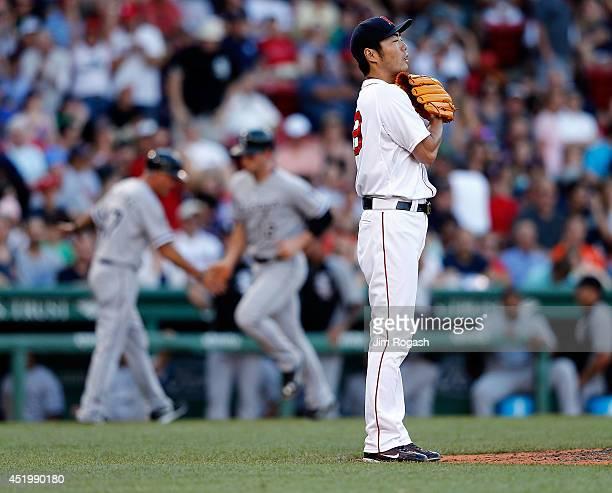 Koji Uehara of the Boston Red Sox reacts after gave up a home run to Conor Gillaspie of the Chicago White Sox in the ninth inning at Fenway Park on...