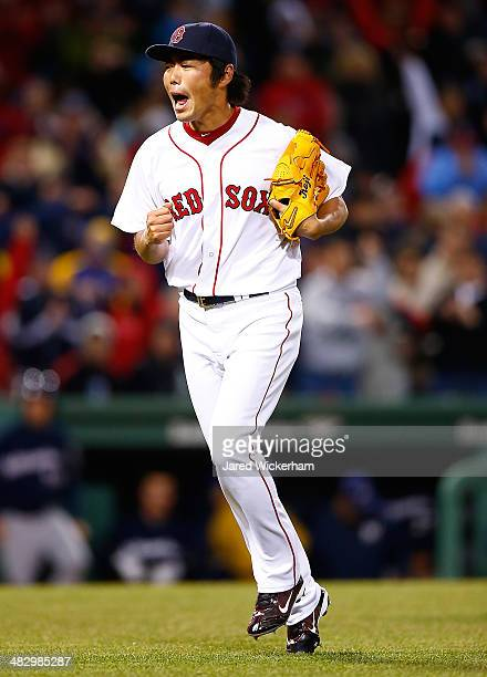 Koji Uehara of the Boston Red Sox reacts after getting out of the 9th inning against the Milwaukee Brewers during the game at Fenway Park on April 5...