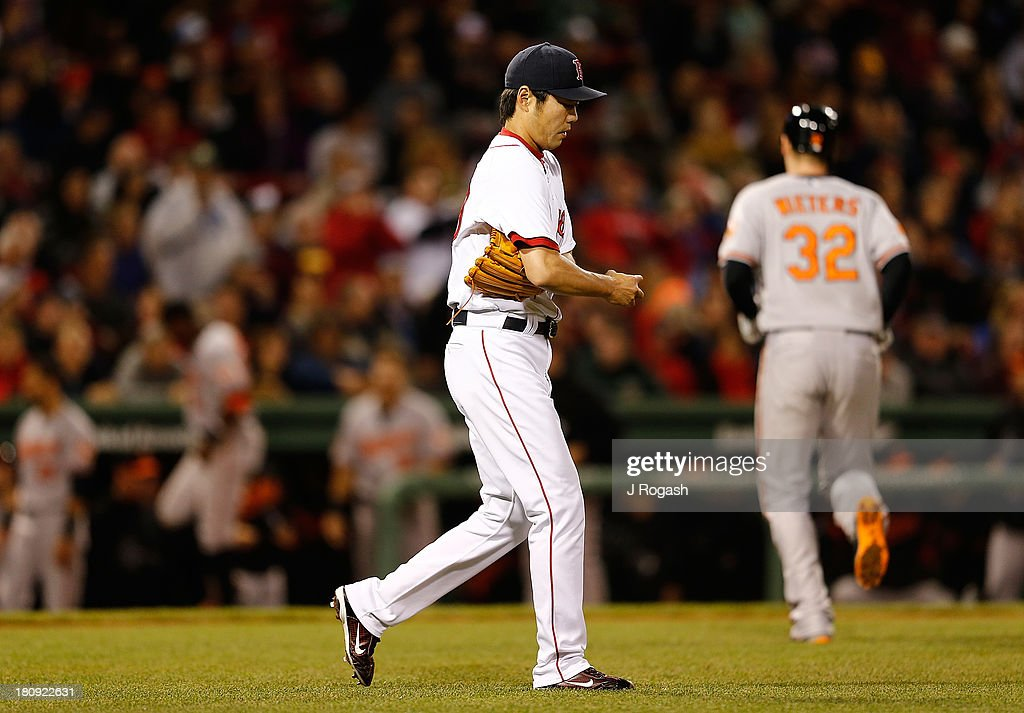 Koji Uehara #19 of the Boston Red Sox reacts after giving up a run-producing sacrifice fly to Matt Wieters #32 of the Baltimore Orioles in the 9th inning at Fenway Park on September 17 in Boston, Massachusetts.