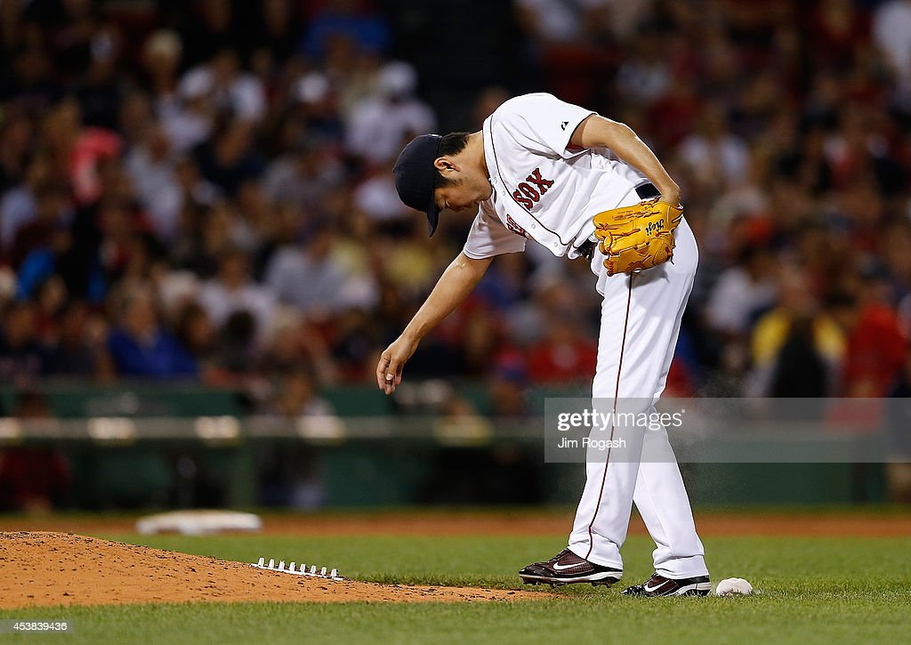 Koji Uehara #19 of the Boston Red Sox reacts after giving up the go-ahead run in the ninth inning against the Los Angeles Angels of Anaheim at Fenway Park on August 19, 2014 in Boston, Massachusetts.