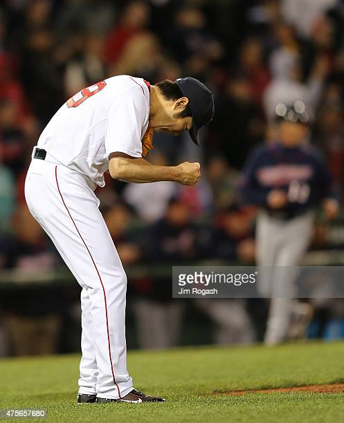 Koji Uehara of the Boston Red Sox reacts after he pitched a scoreless ninth inning against the Minnesota Twins earning the Red Sox a 10 win at Fenway...