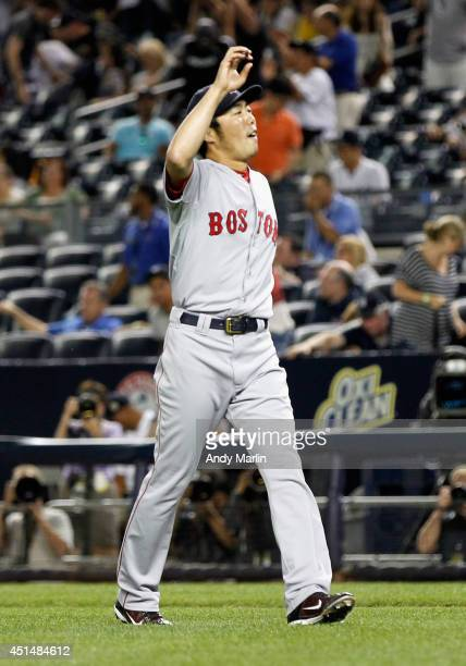 Koji Uehara of the Boston Red Sox reacts after pitching the ninth inning and getting a save against the New York Yankees at Yankee Stadium on June 29...