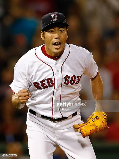 Koji Uehara of the Boston Red Sox reacts after the final out against the Kansas City Royals to give the Red Sox a 21 win at Fenway Park on July 19...