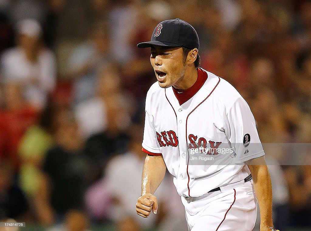 Koji Uehara #19 of the Boston Red Sox reacts against the Tampa Bay Rays after a scoreless 9th inning at Fenway Park on July 23, 2013 in Boston, Massachusetts.