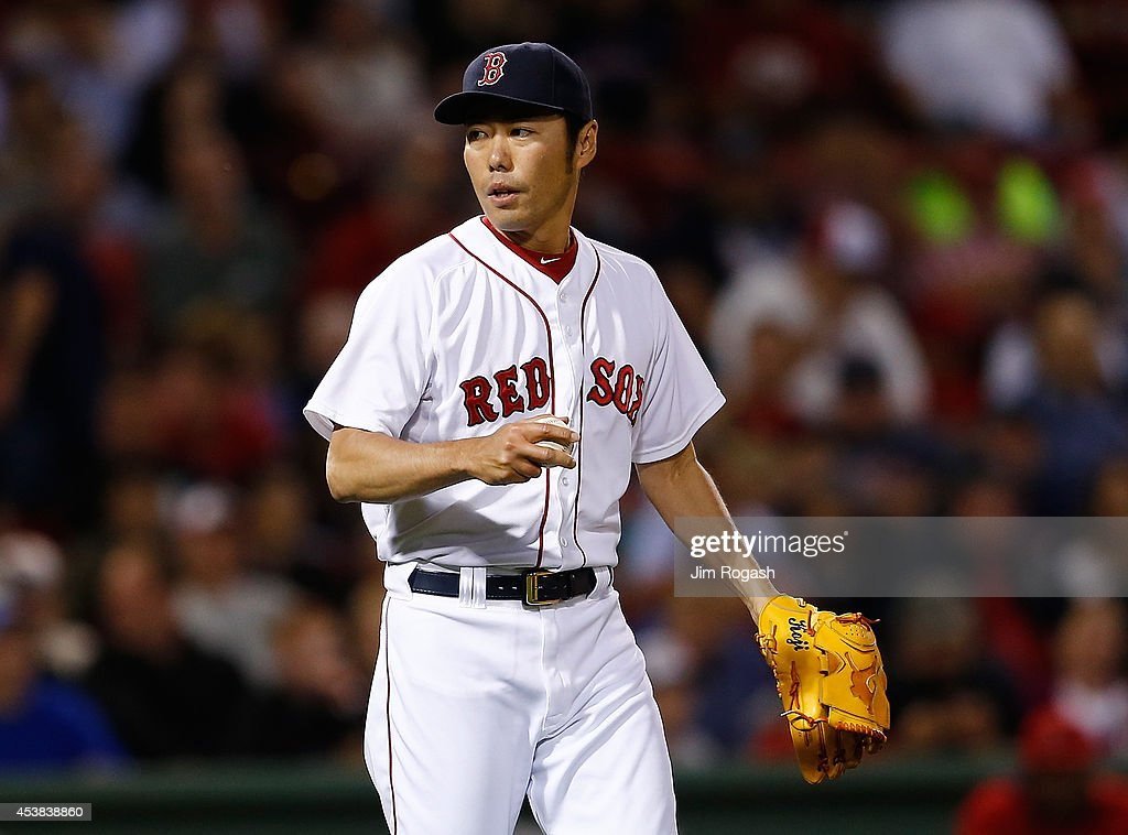 Koji Uehara #19 of the Boston Red Sox reacts in the ninth inning against the Los Angeles Angels of Anaheim at Fenway Park on August 19, 2014 in Boston, Massachusetts.
