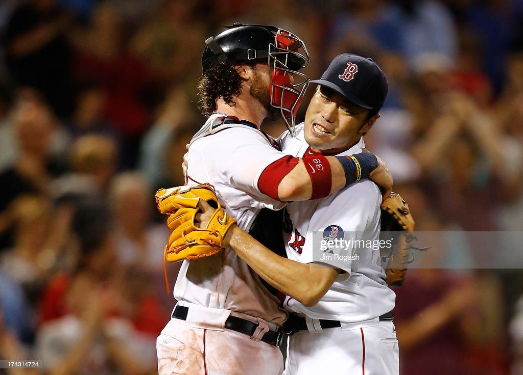 Koji Uehara #19 of the Boston Red Sox reacts with Jarrod Saltalamacchia #39 against the Tampa Bay Rays after a scoreless 9th inning at Fenway Park on July 23, 2013 in Boston, Massachusetts.