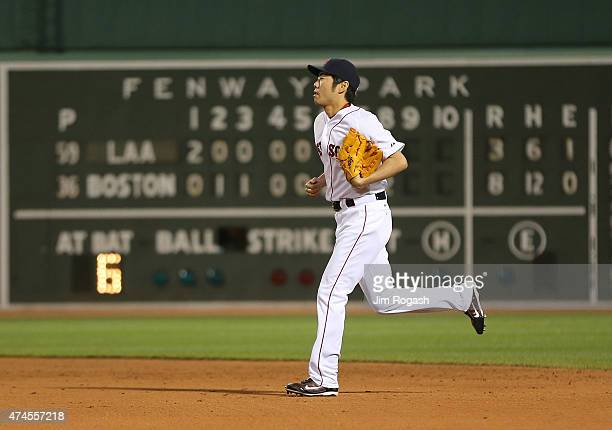 Koji Uehara of the Boston Red Sox runs in to throw in the ninth inning against the Los Angeles Angels at Fenway Park on May 23 2015 in Boston...