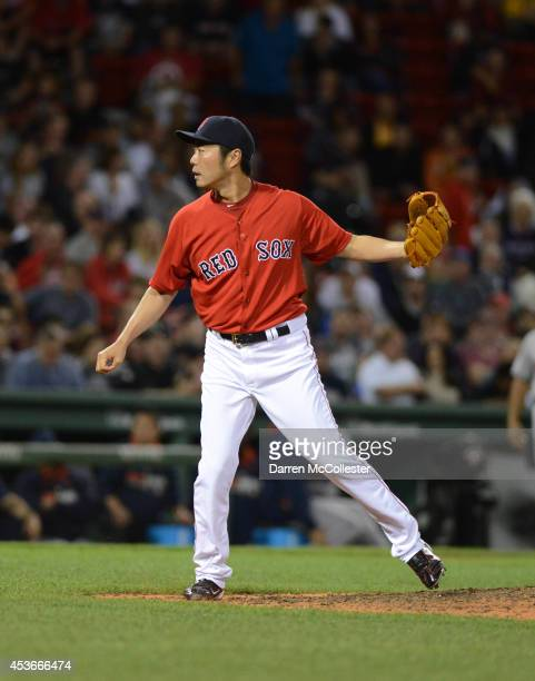 Koji Uehara of the Boston Red Sox throws a pitch in the eighth inning against the Houston Astros at Fenway Park on August 15, 2014 in Boston,...