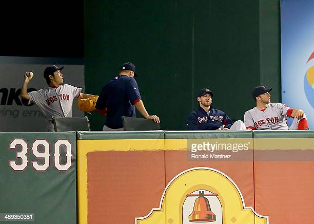 Koji Uehara of the Boston Red Sox throws in the bullpen during a game against the Texas Rangers at Globe Life Park in Arlington on May 10 2014 in...